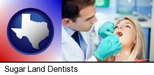 Sugar Land, Texas - a dentist examining teeth