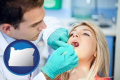 a dentist examining teeth - with Oregon icon