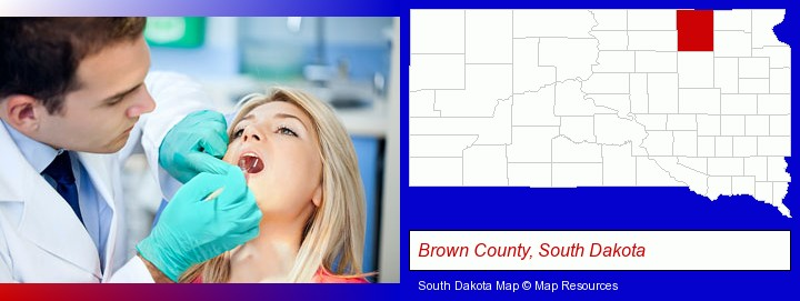 a dentist examining teeth; Brown County, South Dakota highlighted in red on a map